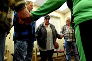 (NOTE: We have permission to photograph everybody in this photo and use their name as written in the following caption.) Vicki Burkhow, center, standing by Steve S., left, and Jim Hartman and others close a meeting with a 12-step prayer at Silver Sobriety in Stillwater, a non-residential recovery program that offers education, recovery services and support to adults ages 50 and older. (Jean Pieri / Pioneer Press)
