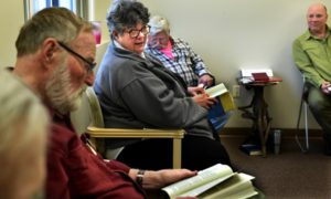 (NOTE: We have permission to photograph everybody in this photo and use their name as written in the following caption.) Vicki Burkhow, center, between Tom Nelson, left, and Jim Hartman, attends a meeting at Silver Sobriety in Stillwater, a non-residential recovery program that offers education, recovery services and support to adults ages 50 and older. Program director, Peter Oesterreich, is on the right. (Jean Pieri / Pioneer Press)